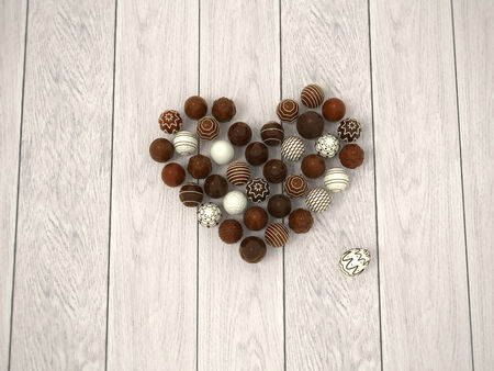 truffle: Photorealistic chocolate Easter eggs heart on white wooden floor from top view - hi-res 3d rendered picture with light vignette  Stock Photo