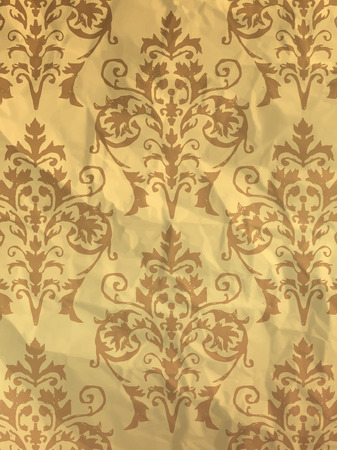 wrapper: Vintage yellow wrapping paper with wallpaper pattern on crumpled paper texture