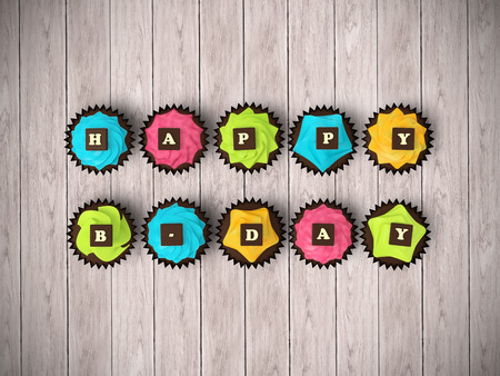b day party: Happy Birthday cupcakes - top view render illustration of colorful muffins with cream and chocolate letters clipping path on bright hardwood background