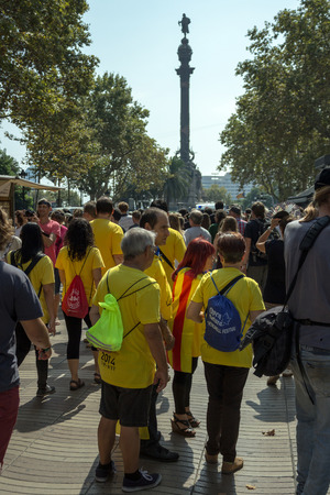 croud: BARCELONA, SPAIN - SEPTEMBER 11, 2014 - Croud of people manifestating vote to independence for Catalonia on La Rambla street on front Columbus monument.