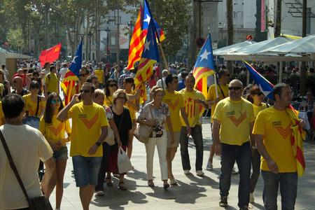 croud: BARCELONA, SPAIN - SEPTEMBER 11, 2014 - Croud of people manifestating vote to independence for Catalonia on La Rambla street.