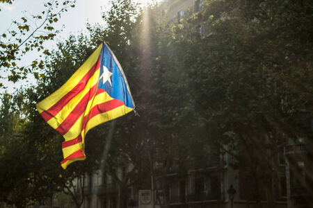 separatist: Flag of Catalonia on the street of Barcelona during the National Day of Catalonia on Sept. 11, 2014 Barcelona, Spain