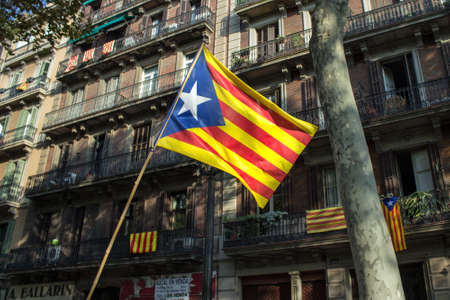 separatist: Flag of Catalonia on the street of Barcelona during the National Day of Catalonia on Sept. 11, 2014 in Barcelona, Spain.