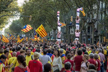 strret: BARCELONA, SPAIN - SEPT. 11: People manifesting ingependence on the strret of Barcelona during the National Day of Catalonia on Sept. 11, 2014 in Barcelona, Spain.