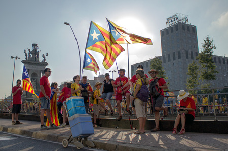 strret: BARCELONA, SPAIN - SEPT. 11: People manifesting ingependence on the strret of Barcelona during the National Day of Catalonia on Sept. 11, 2014 in Barcelona, Spain. Editorial