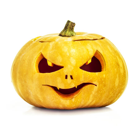 pumpkin face: Scary Halloween yellow pumpkin face isolated on white background with clipping path
