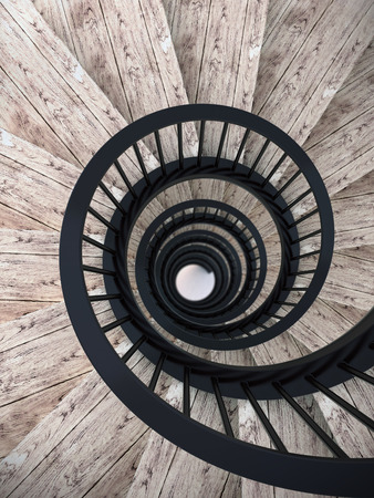 stairs interior: Spiral wood stairs with black painted balustrade