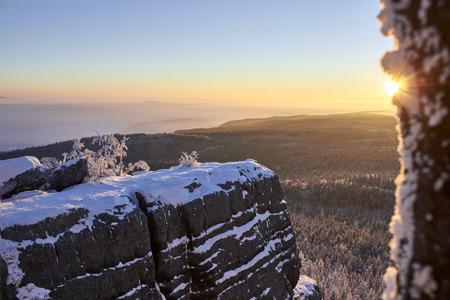 sudetes: Winter sunrise up the mountain forest in snowy rocks. Sudetes, Poland, Europe. Amazing world. Stock Photo