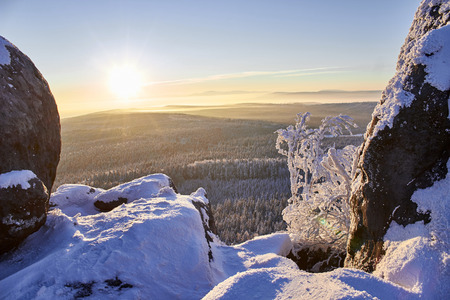sudetes: Winter sunrise up the mountain forest in snowy rocks. Sudetes, Poland, Europe. Stock Photo
