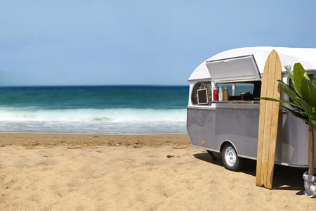 surf board: Surfing slow food, caravan on the beach, template with copy space