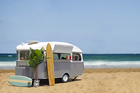 Surfing fast food truck, caravan on the beach, horizontal template with copy space. Stock Photo