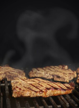 American style steak BBQ black background with copy space Standard-Bild