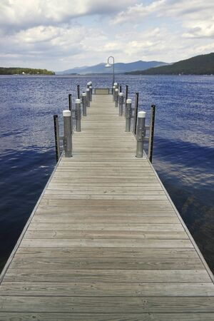 jetty: Pier on Lake George with mountains in the background Stock Photo