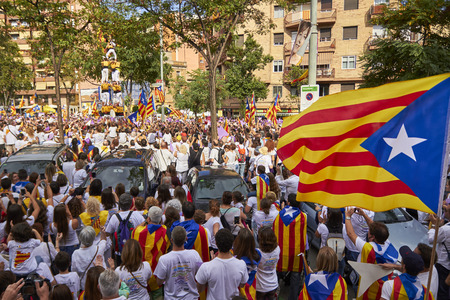 atraction: BARCELONA, SPAIN - September 11, 2015: Yellow Castelliers traditional tower at the day of Catalonia Editorial