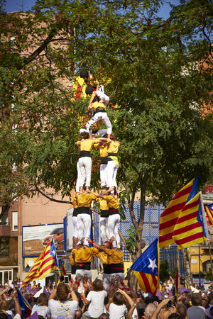 11: BARCELONA, SPAIN - September 11, 2015: Yellow Castelliers traditional tower at the day of Catalonia Editorial