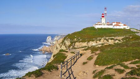 roca: View of a lighthouse with the ocean in Cap da Roca, Portugal Stock Photo