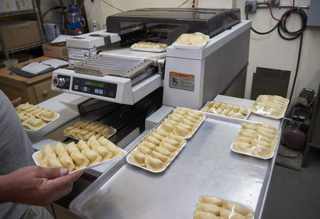 Half-automated packaging of polish dumplings production Stock fotó