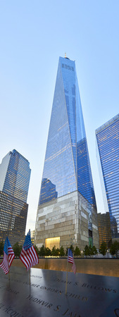 national historic site: NEW YORK - JULY 29: Freedom Tower in Manhattan on July 29, 2015. One World Trade Center and part of 911 Memorial Museum Downtown Manhattan.