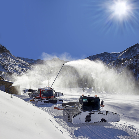 snow grooming machine: Ratracks vehicles for snow preparation at ski resort in Andorra, Pyrenees, Europe