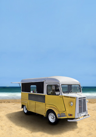 Yellow retro fast food truck on the beach, vertical template with copy space Zdjęcie Seryjne