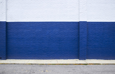 brick wall: Painted on blue brick wall on the street