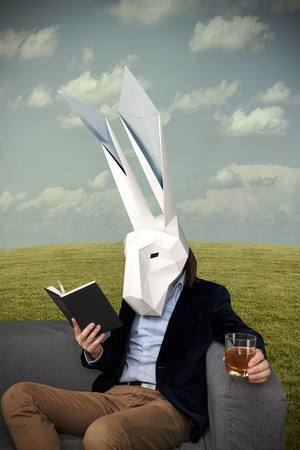 Gentleman in the white geometrical rabbit mask relaxing Stock fotó
