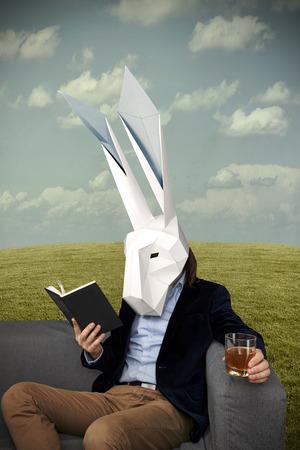 Gentleman in the white geometrical rabbit mask relaxing Stok Fotoğraf