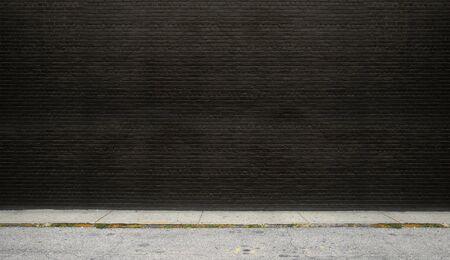 路上で黒とクリアのレンガの壁に描かれました。 写真素材