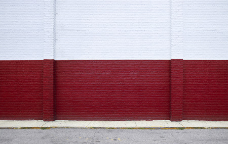 red brick: Painted on red brick wall on the street Stock Photo