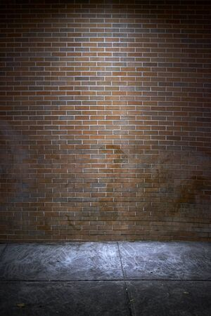 red centre: Spoot light in the centre of red brick wall city background