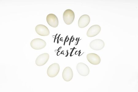 cristian: Happy Easter typography inside of dozen of white eggs on white background in the circle, copy space.