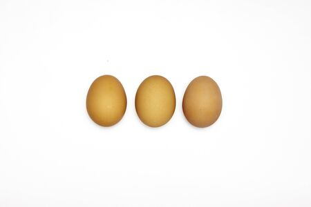 Three of browsn eggs on white background in the horizontal row