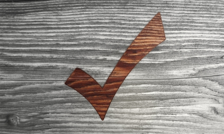 well read: 3d graphic with sustainable check symbol in a stylish wooden  background Stock Photo