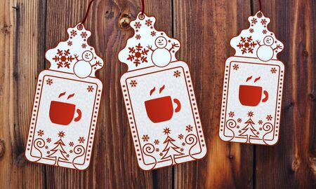 seasonal 3d rendered christmas labels with coffee sticker in front of a nice wooden background photo