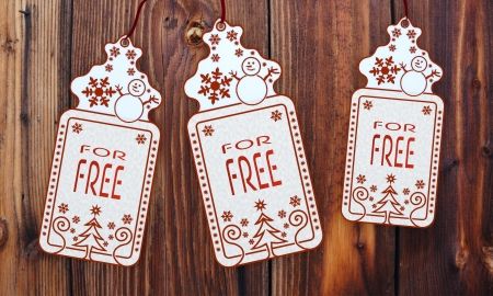 trendy 3d rendered christmas labels with free sign in front of a nice wooden background photo