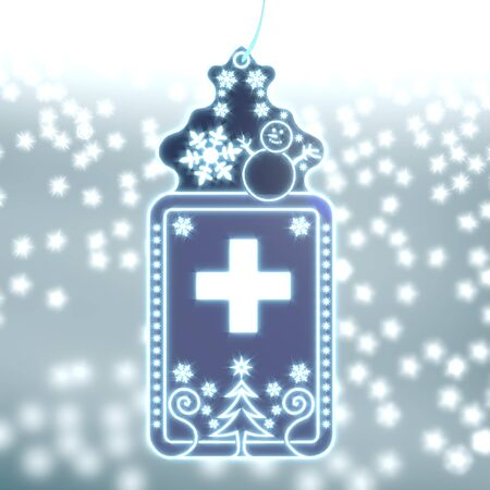 ornamental christmas labe with cross sticker on ice blue blurred background with snow and glaring stars photo