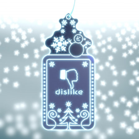 ornamental christmas labe with dislike sticker on ice blue blurred background with snow and glaring stars photo
