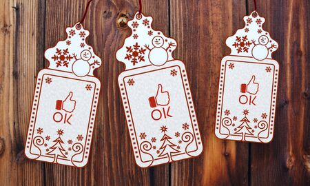 trendy 3d rendered christmas labels with ok sticker in front of a nice wooden background photo