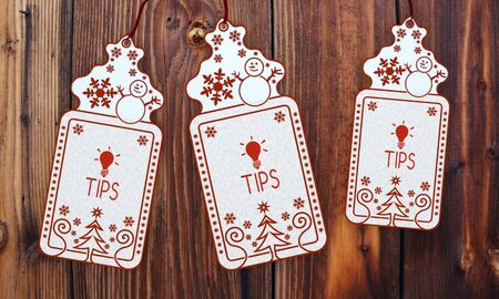 trendy 3d rendered christmas labels with tip sign in front of a nice wooden background photo