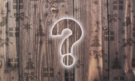 unresolved: undissolved wooden question label on wood with burned in christmas symbols such as snowflakes presents and stars