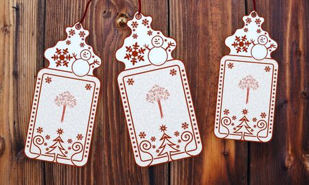 autumnn: ornamental 3d rendered christmas labels with abstract tree sticker in front of a nice wooden background