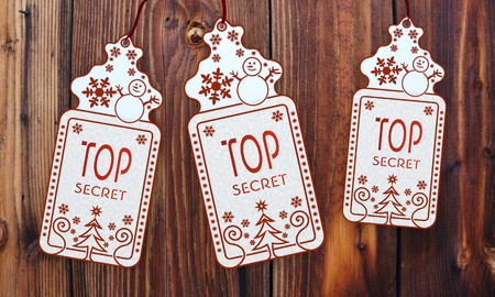 friendly 3d rendered christmas labels with top secret sticker in front of a nice wooden background photo