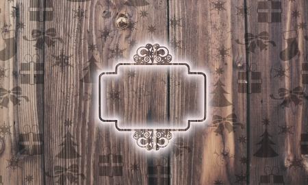 curlicue: seasonal wooden curlicue label symbol on wood with burned in christmas symbols such as snowflakes presents and stars