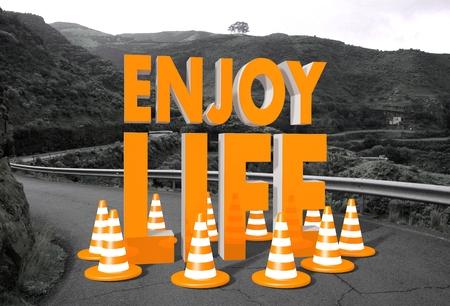 enjoy life: arancione godere simbolo di vita su una strada di campagna in <