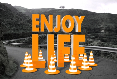 enjoy life: orange enjoy life symbol on a countryside road in  Stock Photo