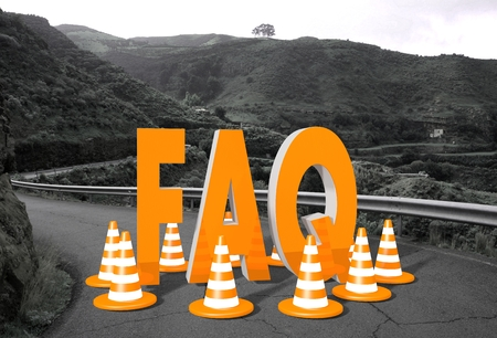 orange faq symbol on a countryside road in <<remote landscape blocking the way like a construction site Stock Photo - 27622013
