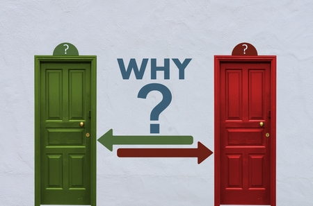 where is the why behind the red or the green door? A concept image showing two wooden doors with a why symbol painted on the wall in between Stock Photo - 27622060
