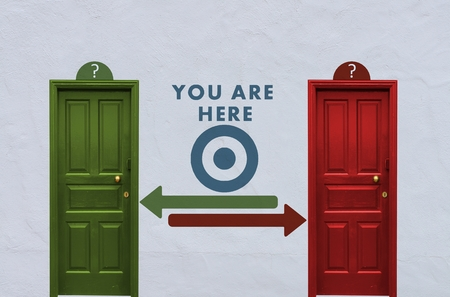 where is the you are here behind the red or the green door? A concept image showing two closed doors with a you are here symbol painted on the wall in between photo