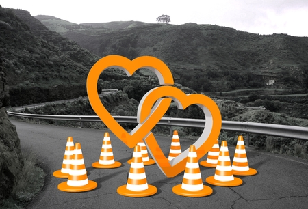 orange two hearts sign on a countryside road in  photo
