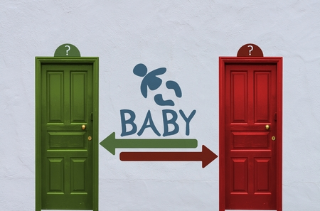 where is the baby behind the red or the green door? A concept image showing two old doors with a baby symbol painted on the wall in between photo